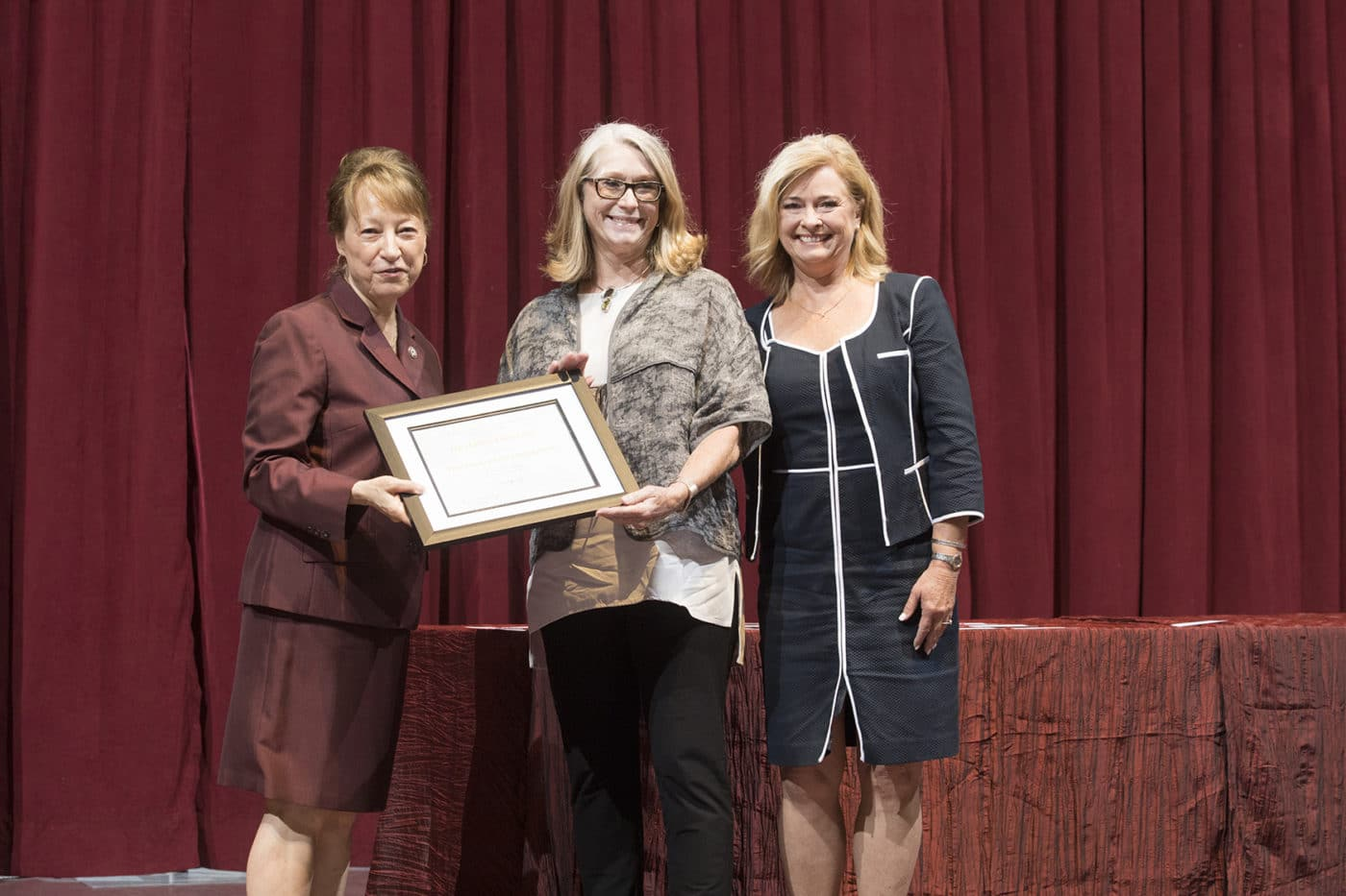 Lynn Denton receives the Teaching Award of Honor from President Trauth and Alumni Association President Cindy Williams