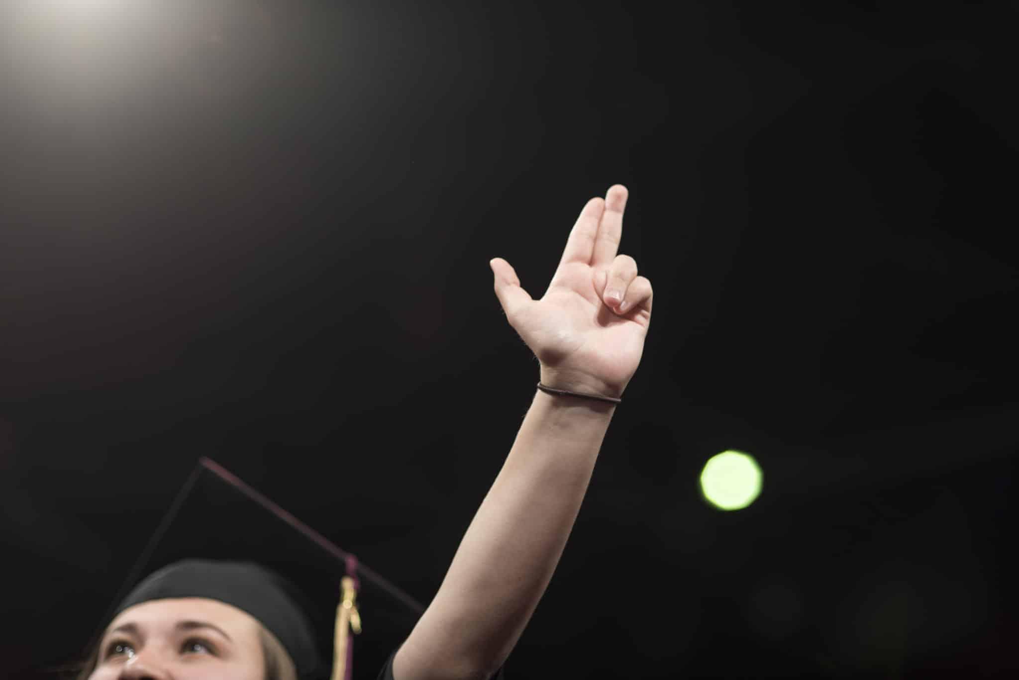 hand sign at graduation