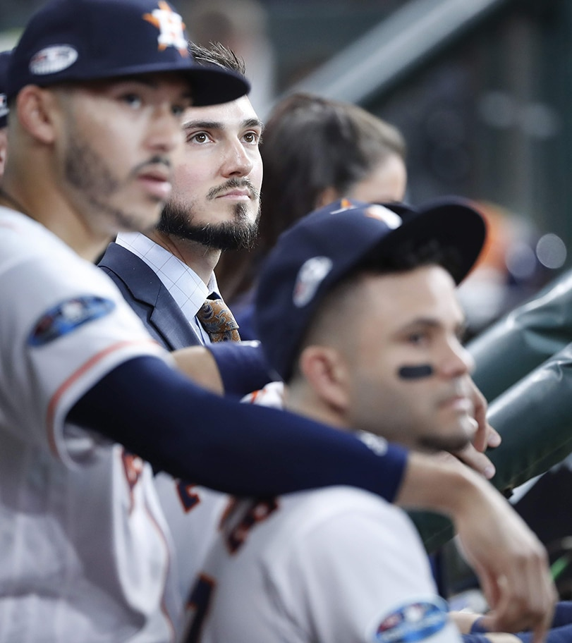 Steve Grande, Houston Astros Senior Manager of Communications, shortstop Carlos Correa and second baseman Jose Altuve watch a video montage on the scoreboard before Game 1 of the American League Division Series against the Cleveland Indians on Friday, Oct. 5, 2018 at Minute Maid Park. The Astros beat the Indians 7-2.